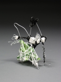 """Tiny Dancers"" Wire and embroidery floss as stylized initials (""A"" in the tux and ""G"" in the dress). Each 3"" x 5"". 2011."