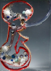"""""""Gastroscope"""" Sculpture pressed between glass. For memory project. Plastic canvas, acrylic gel, plastic tubing, marbles, beads, tissue paper and seran wrap. 10""""×16″. 2011."""